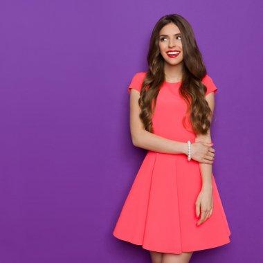 Smilin Girl In Pink Mini Dress Looking Away