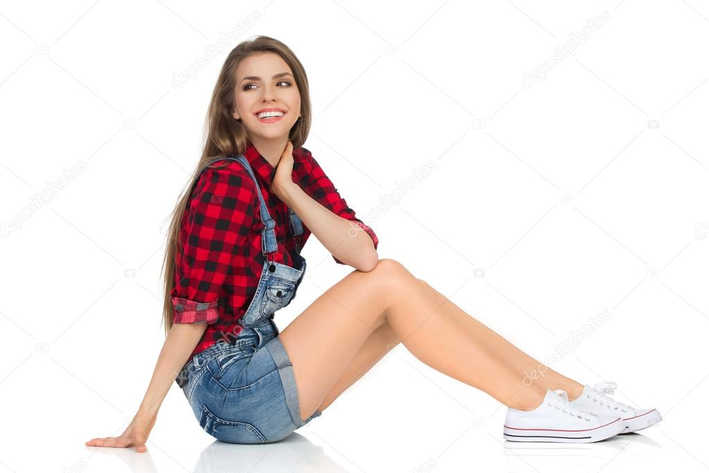 Smiling Girl Sitting On A Floor Side View