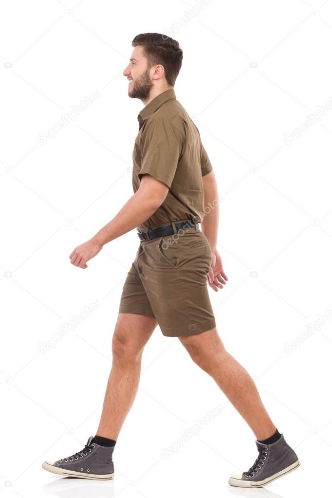 Walking man in khaki uniform