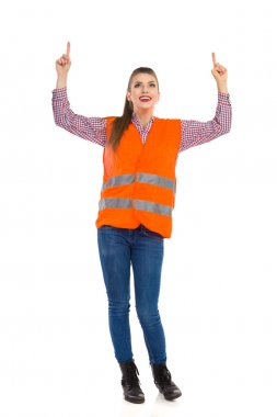 Woman In Orange Reflective Vest Pointing Up