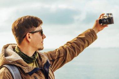Man makes self-portrait with vintage camera