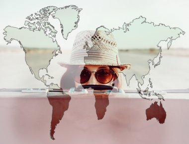 Double exposure map of world with traveler woman