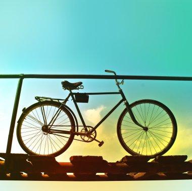 Retro bike on an old wooden bridge.