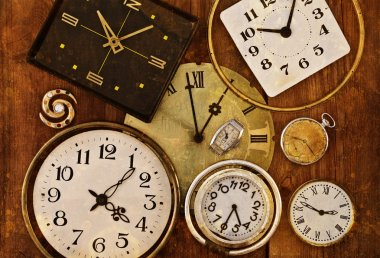 Old clocks on a grungy background