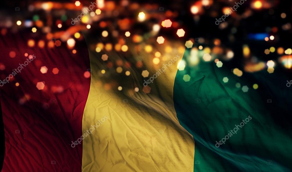 ギニア国旗光夜ボケ抽象的な背景...