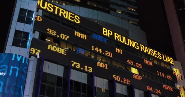 Stock market ticker at night