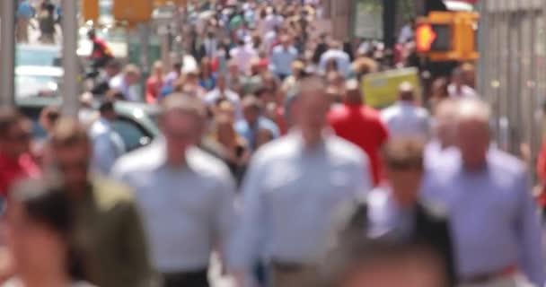 people walking on city street sidewalk