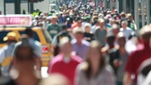 people walking on street sidewalk
