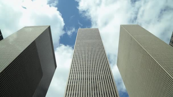 clouds move over office buildings