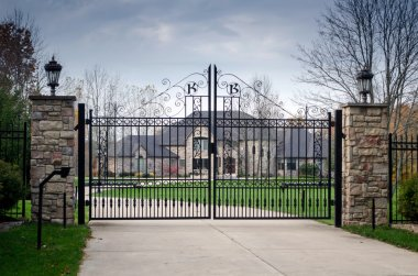 Large fancy mansion behind a gated entry