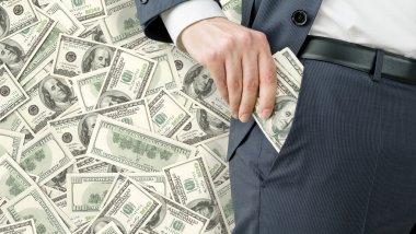 Businessman getting money
