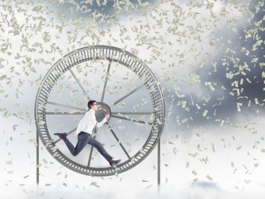 Man in spinning wheel