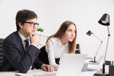 Businessman and businesswoman in office