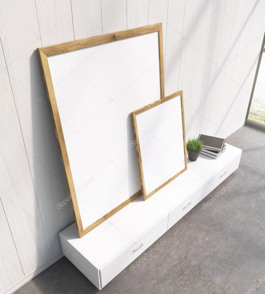 Two Blank Frames On White Floor Shelf White Wooden Wall Side View