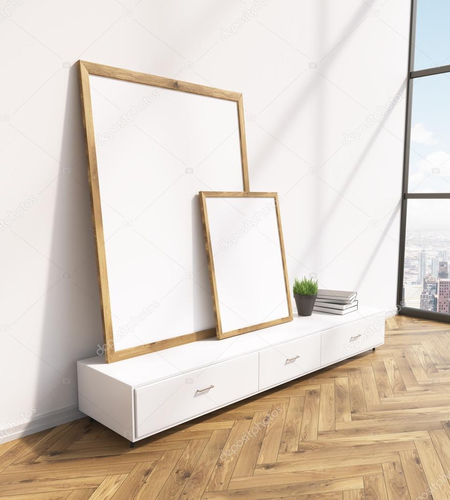 two blank frames on white floor shelf white wall window to the  - two blank frames on white floor shelf white wall window to the right