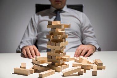 Businessman wooden blocks desk