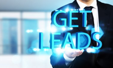 Man holding get leads writing