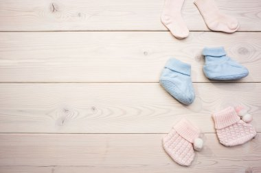 Baby socks on wooden surface
