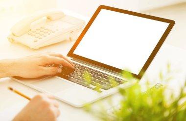 Man using laptop on desktop