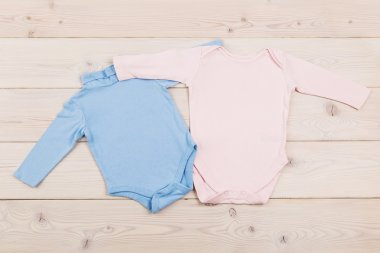 Baby clothes on wooden table