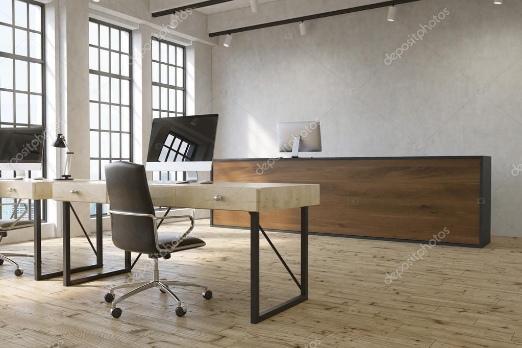 Modern Office Interior With Blank Computers On Tables, Wooden Reception  Desk And Windows With City
