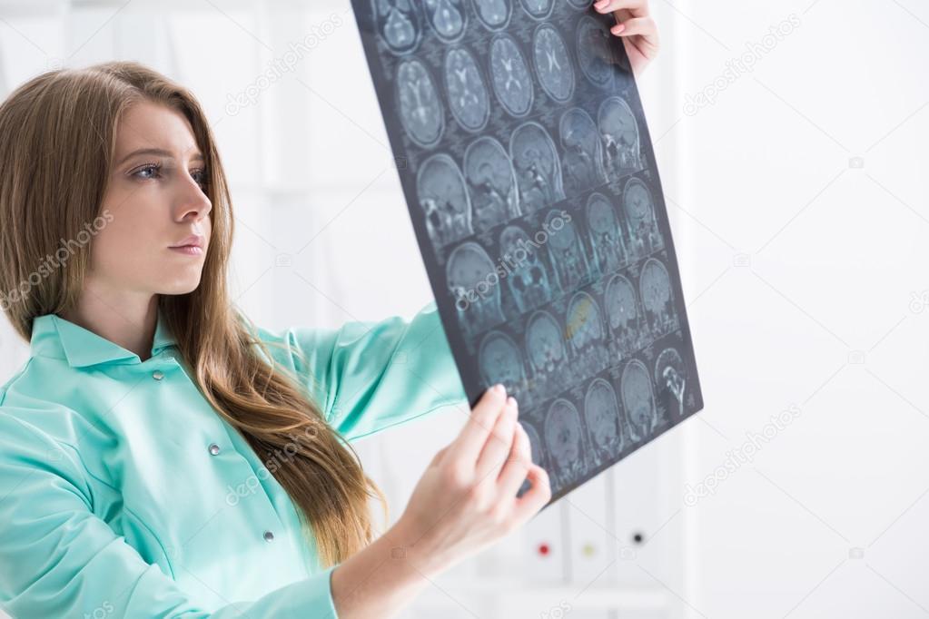 Brain surgeon in green gown — Stock Photo © denisismagilov #124713310