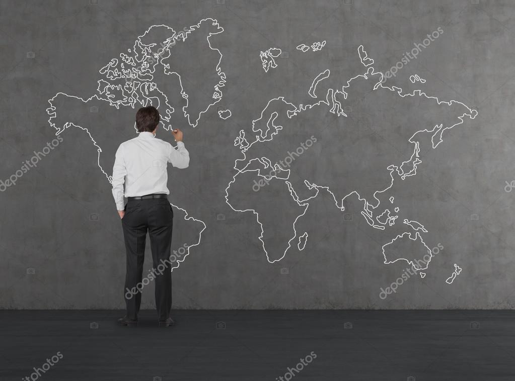 Man drawing world map stock photo denisismagilov 60487991 businessman drawing world map on concrete wall photo by denisismagilov gumiabroncs Gallery