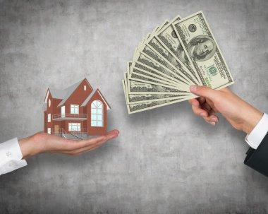 hand giving money for housing