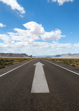 road with gray arrow