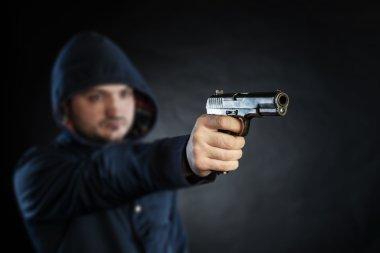 killer holding gun