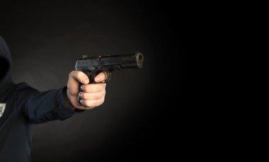 killer shooting a gun