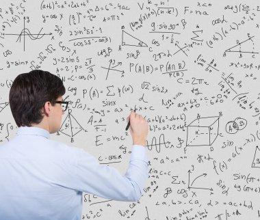 businessman drawing formulas