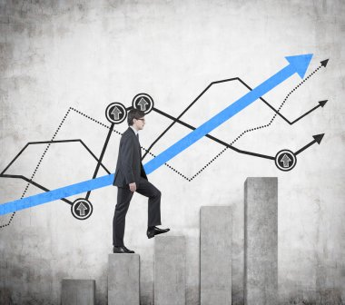 businessman walking on graph