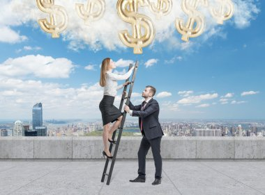 Businessman holds a ladder for the business lady. The concept of the teamwork. On the roof terrace in Manhattan. Dollar icons falling from the sky.