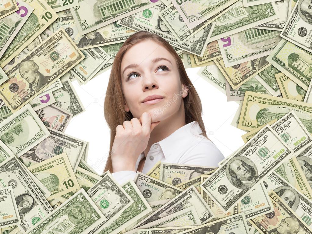 Ein Mädchen lächelnd in den Us-Dollar Rechnungen Rahmen hinein. Alle ...