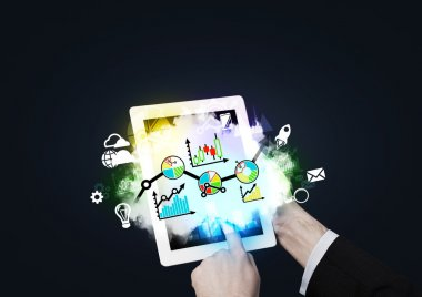 Close up of hands pushing the tablet's screen. Digital analytics solutions.
