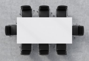 Top view of a conference room. A white rectangular table and eight black leather chairs around. 3D interior.