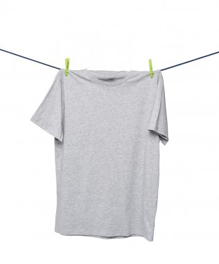 Close up of a grey t-shirts on the rope. Isolated.