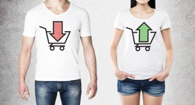 Close up of the bodies of man and woman in a white t-shirts with two sketches: a basket with red arrow and a basket with green arrow. A concept of trading processes. Concrete background.
