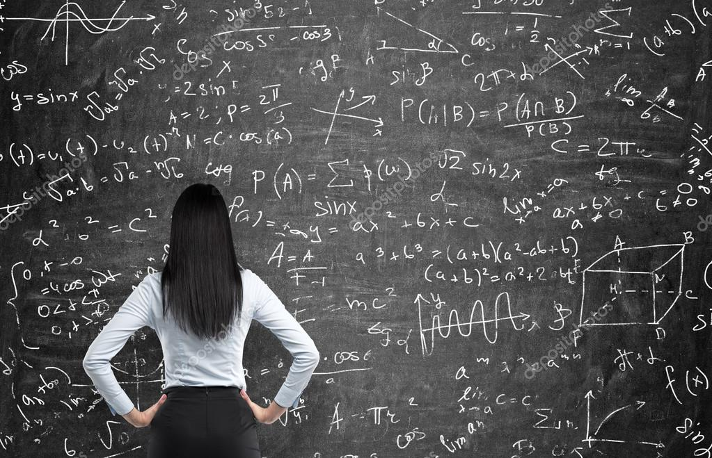 Rear view of a thoughtful woman who tries to solve math problems ...