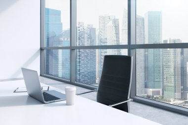 A workplace with laptop and a cap of coffee in a modern panoramic office, Singapore City view. A concept of financial consulting services. 3D rendering.