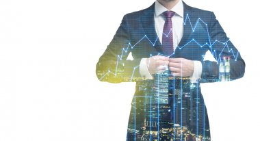 A transparent silhouette of a man in formal suit. Panorama of evening New York city. Financial chart is over the silhouette.