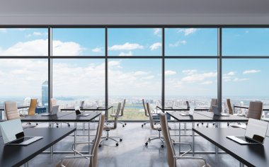 Workplaces in a modern panoramic office, New York city view from the windows. Open space. White tables and brown leather chairs. A concept of financial consulting services. 3D rendering.