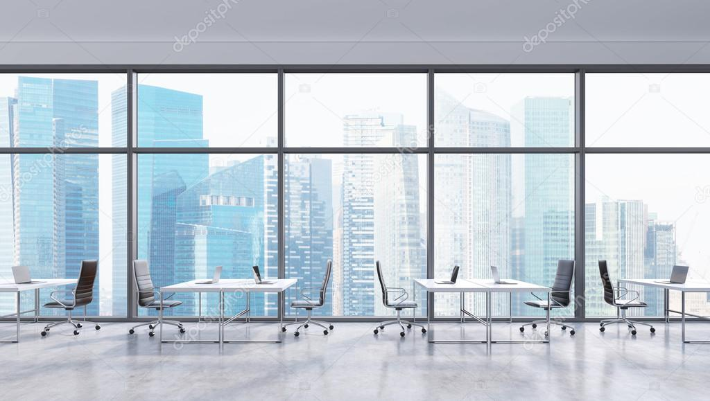 Workplaces in a modern panoramic office singapore city view in the windows open space