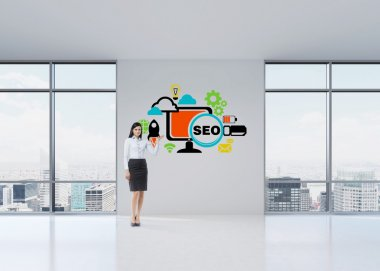 Full length brunette girl in a formal clothes is pointing out the ' SEO ' sketch. A modern panoramic office in Manhattan, New York.