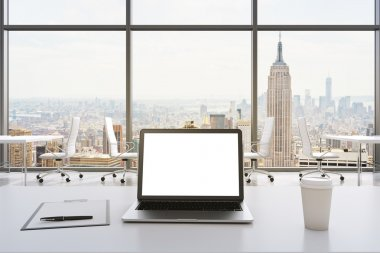 Front view of the workplace in a modern panoramic office in New York. White tables and white chairs. A laptop with a white display, notepad and a coffee cup are on the table. 3D rendering.