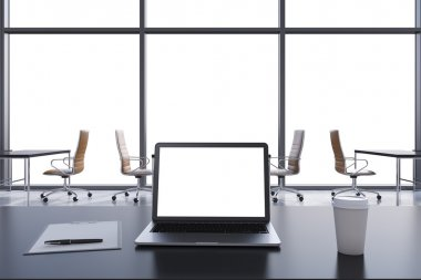 Front view of the workplace in a modern panoramic office with copy space in the windows. Black tables and brown chairs. A laptop with a white display, notepad and a coffee cup. 3D rendering.