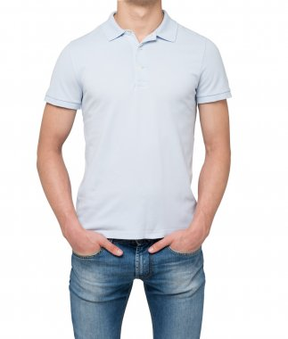 Man wearing light blue polo shirt and denims. Hands are in the pockets. isolated on white background.