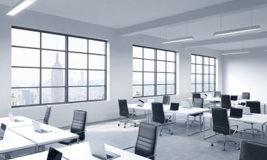 Corporate workplaces equipped by modern laptops in a modern panoramic office with New York view. Black leather chairs and white tables. 3D rendering.