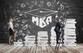 A woman is going up using a stairs which are made of white books to reach graduation hat, while a man has found a shortcut to get MBA degree. A black chalkboard with the written word MBA.